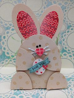 This cute paper bunny is actually attached to a basket, what a fun idea for Easter treats!