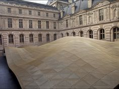 The Louvre's newest architectural addition is tucked away in the interior courtyard of the Denon Wing. Designed by Rudy Ricciotti and Mario Bellini, the Islamic Arts department, which opened in 2012, is topped by an undulating gold roof that's reminiscent of a sand dune.