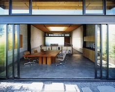 A roundup of spaces (both interior and exterior) featuring steel windows and doors, from the Remodelista Architect/Designer Directory. For ideas on steel d Steel Windows, Windows And Doors, Pivot Doors, Internal Doors, Sliding Glass Door, Glass Doors, Sliding Doors, Metal Doors, Concrete Floors
