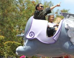 Flying high: Kim took North to ride upon Dumbo The Flying Elephant ride