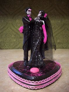 Because no cake is complete without a skeleton on top. The pink would need to be changed to blue...