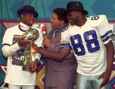 Deion Sanders and Michael Irvin hold the Lombardi trophy after winning Super Bowl XXX on January 28, 1996.
