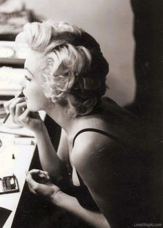 Photo of Marilyn Doing Her Makeup for fans of Marilyn Monroe.