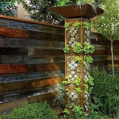 Vertical garden tower - Favorite DIY Garden Projects - Sunset - good for water collection? Jardim Vertical Diy, Vertical Garden Diy, Vertical Gardens, Vertical Planting, Small Space Gardening, Small Gardens, Outdoor Gardens, Landscape Design, Garden Design