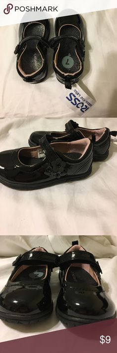 Toddlers black shoes Black toddler dress shoes carter brand with flower detail on side of Velcro closure strap. Brand new with tags, never worn.smoke free/pet free home. Carter's Shoes Dress Shoes