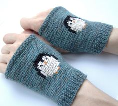"""Knit these tiny penguins to keep you company! I wear mine all the time! The little penguin is so cute, and so easy to make using duplicate stitch embroidery. They feature a seed stitch border at the top, and 3/4"""" ribbing at the cuff."""