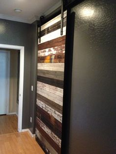 Reclaimed Mixed Beadboard Sliding Barn Door. This would be an awesome accent door in a very modern house!