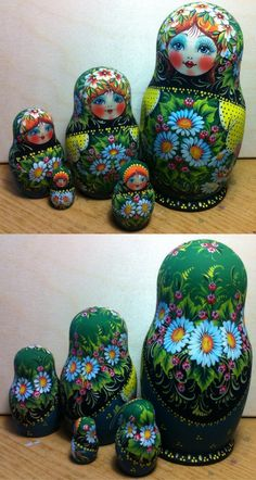 Russian nesting doll in green design with chamomiles painting