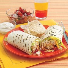 Chicken Burritos:  Serve these satisfying burritos with baked tortilla chips and extra salsa, or some ready-made guacamole. #leftovers #rotisseriechicken