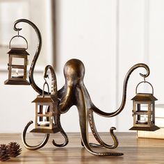 Made by SPI Home. Brand: SPI Home. Octopus Lantern by SPI Home. 725739340660 Part: Item: Octopus Lantern by SPI Home Dimensions: 15 inches Tall x 18 inches Wide x inches Deep; Made of: Aluminum Glass Lantern Candle Holders, Candle Lanterns, Hurricane Candle, Hanging Lanterns, Lantern Tile, Diy Candles, Coastal Living, Coastal Decor, Nautical Home Decorating