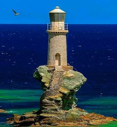 A place I'd like to see - islands off the coast of Greece - photo: Tourlitis Lighthouse, Andros Island. Makes you aware how much the coastline has been worn away by weather & sea & changed by the centuries (a guide). Pays Europe, Animal Original, Lighthouse Pictures, Lighthouse Keeper, Lighthouse Art, Beacon Of Light, Water Tower, Am Meer, Greek Islands