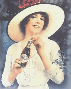 1910.  Coca Cola has a long history of advertising with cute pin-up girls who were always wholesome and G-rated and very attractive.  No girl would ever have minded looking like any of these.