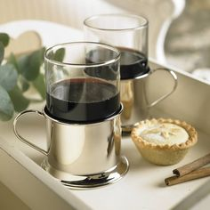 Six nickel plated and glass wine glasses