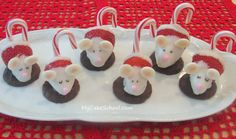 Chocolate Dipped Strawberry mice. Chocolate dipped strawberries, candy cane tail, on a chocolate covered cookie