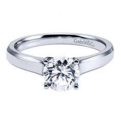 14k white gold solitaire round diamond cathedral engagement ring Love this!