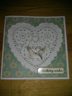 Birthday card made by my daughter. Heat embossed onto doily