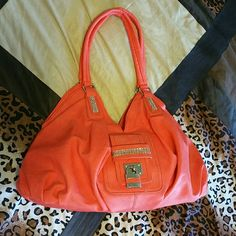 Large coral purse It has a zipper pocket on the outside back, one zipper pocket on the inside back and two other pockets on the inside front for cell phone, etc. The inside is chocolate brown with no wear. It is about 5 inches wide at the bottom, from the main pocket opening to the bottom it's about 8 inches tall and about 18 inches long. Only used a few times.  No trades! To save, make me an offer or bundle with my 25% discount! Bags Shoulder Bags