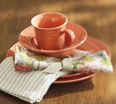 the dishes are beautiful, but I really just like the simple napkin ring used here