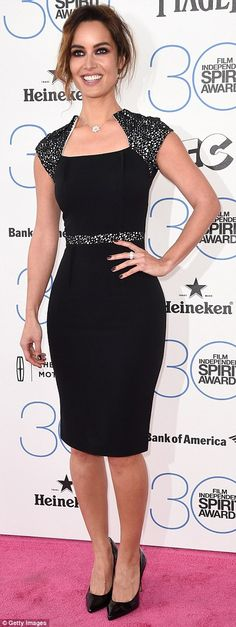 Diamonds are a girl's best (red carpet) friend: The former Bond girl had bling on her hand...