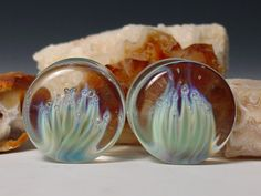 "Lotus thistle ear plug 7/8"" gauge  handblown glass pendant piercing jewelry. $39.95, via Etsy."