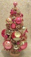 Bottle brush tree full of vintage ornaments