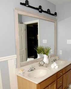 s 10 stunning ways to transform your bathroom mirror without removing it, bathroom ideas, home decor, Glue on molding for a decorative frame
