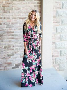 This elegent Athena Black Floral Maxi Dress features deep pink floral accented by blues and greens. The silky smooth material will make you fall in love! || Bella Ella Boutique  Womens Boutique Fashion. Maxi Dress. Fall. Floral. Pink. Modest. Wrap Dress.