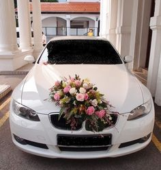 wedding car BMW with all white rose or red on top instead