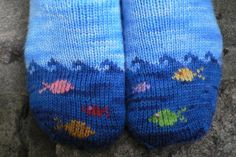 Fish in the Sea is a whimsical sock design sized for both children and adults. Fish in the Sea is a whimsical sock design sized for both children and adults. The detailed pattern includes instruction. Knitted Booties, Knitted Slippers, Knit Mittens, Knitting Socks, Hand Knitting, Knitting Patterns, Knit Socks, Baby Booties, Knitting Projects