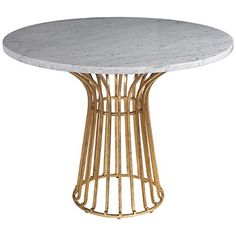 White marble stands out beautifully against the antique gold finish base of this round dining table.