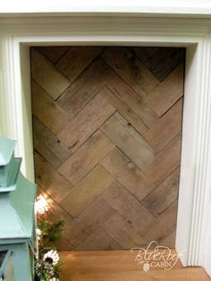 faux fireplace pallet wood fire box, fireplaces mantels, home decor, pallet wood laid in a herringbone pattern Candles In Fireplace, Small Fireplace, Concrete Fireplace, Fireplace Hearth, Country Fireplace, Cottage Fireplace, Fireplace Garden, Fireplace Cover, Shiplap Fireplace