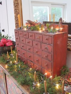 Red Paint 26 Drawer Hanging Apothecary Chest Dressed for Christmas. Primitive Christmas, Country Christmas, All Things Christmas, Vintage Christmas, Christmas Christmas, Primitive Snowmen, Primitive Crafts, Primitive Homes, Primitive Antiques