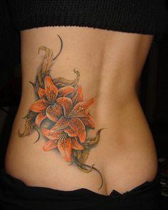 Lilies tattoo by Sergey Korolev