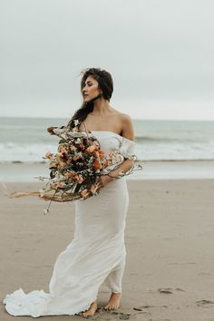 Northern California beach, dreamy florals, boho off-the-shoulder gown | Image by Michelle Larmand Photography
