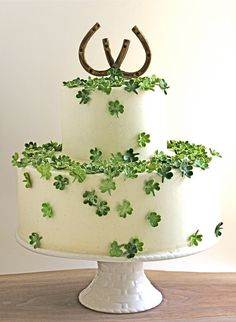 Cute cake for a graduation or new home, job etc.   A cake decorated with candy four-leaf clovers ensures lots of luck for the happy couple.