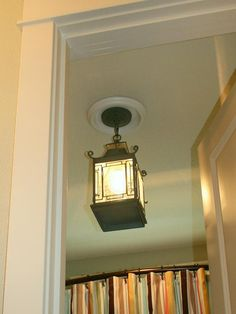 How to replace a recessed light fixture with a stylish pendant fixture --> http://www.hgtv.com/design/rooms/bathrooms/convert-a-recessed-light-into-a-pendant-fixture?soc=pinterest