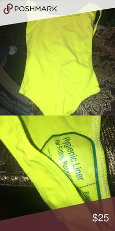 American apparel lime green low cut back Bodysuit * NEW HAS NEVER BEEN WORN * it is a size small I'm not sure how it fits but I'm sure it's true to size being most of their clothes are . Please know that this has NEVER been worn American apparel are closing down all of their stores . So take advantage 😉 absolutely no trades ❌ American Apparel Tops