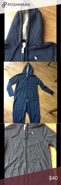 Abercrombie Onesie (Like New) Like New; Abercrombie & Fitch Onesie; Faux Fur inside Hood; Zip Front; Front Pockets; Color: Navy; Fabric: 60% Cotton 40% Polyester; Measures: Sleeves 29.5; Shoulders 20.5; Chest 50; Waist 50; Inseam 34; Size L/XL Abercrombie & Fitch Other