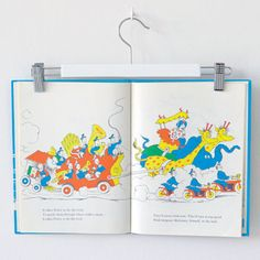 Decorate a kid's wall by clipping picture books onto skirt hangers, then hang up on a wall hook.