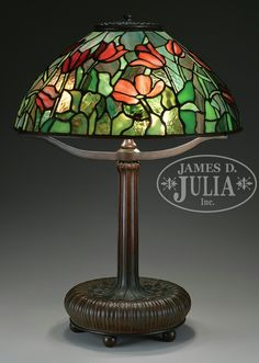 """TIFFANY STUDIOS FAVRILE GLASS CANDLESTICKS. Gold favrile glass candlesticks are gently ribbed with each having an inverted saucer foot which is decorated in a Laurel leaf design. Each is signed on the underside """"LCT Favrile 1826""""."""