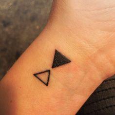 Lovely Tiny tattoo. Abstract sandclock. Geometric Art