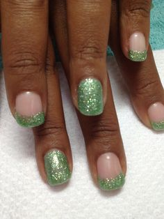 What pretty green glittered French gel nails!!