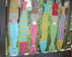 Super cute for fence by a local etsian!  http://www.etsy.com/listing/78725885/mermaid-and-fish-6-piece-wall-grouping?ref=af_you_favitem