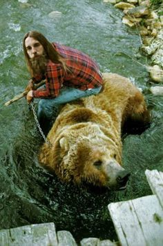Well... since my man looks nearly like this caveman here I guess I have no choice but get ourselves a bear.    But the chain, dude :( not kewl, not kewl man! :/