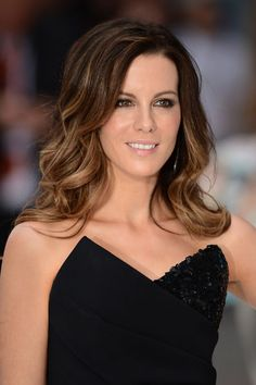 Eye makeup idea (on Kate Beckinsale): A ring of black-brown eyeliner and some shimmery coppery brown eyeshadow.