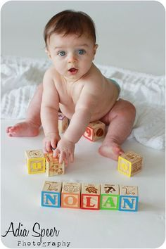 Cute photo idea with baby's name in blocks.  Pin found by Freebies-For-Baby.com
