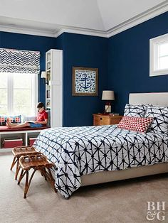 Let your young pirate sail wherever his dreams take him in this classy nautical room. The walls are painted a trendy navy blue, with bedding and window treatments to match. Red accents and an anchor print heighten the look. The best part is that the space can easily change as your boy gets older—just swap out the bedding and accessories for more masculine pieces.