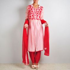 Peach and Red Chanderi Jacket-Trouser Set An ensemble perfect for semi-formal wear. The long jacket has been created with the graceful Chanderi fabric and accented with delicate floral embroidery detail. The set includes a pair of silk trousers and dupatta with lace highlights, which also bring a splash of colour contrast to the appearance. Shop here: http://www.tadpolestore.com/surkh
