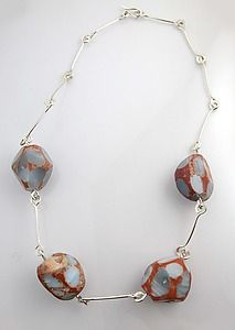 Faceted Geode necklace. The geodes are unopened, leaving them a mystery.