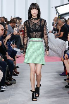 Carven.  Note:  Inspiration for my fishnet top, and my lace top.  Pair something sheer with bear legs for better proportions.  Also something ruff with something feminine. Also - Lots of bangs on the runway this season.
